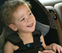 a child on a car seat close up