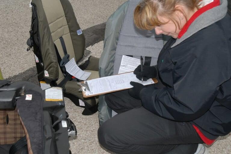 expert inspecting car seats