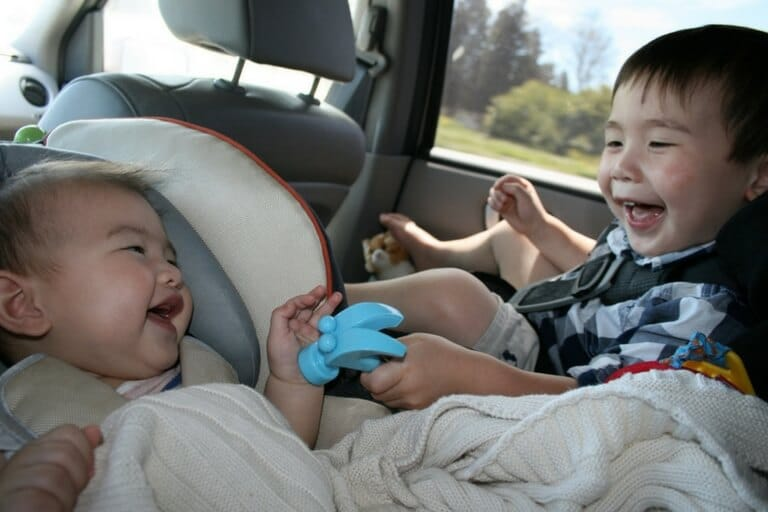 babies in car seats playing