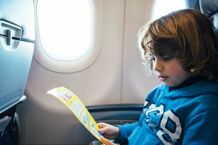 child-reads-the-safety-airplane