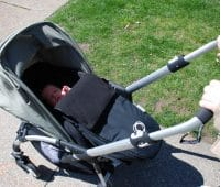 baby in a car seat with UV cover