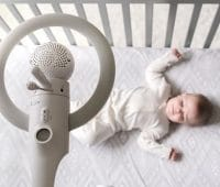 baby in the bed with monitor
